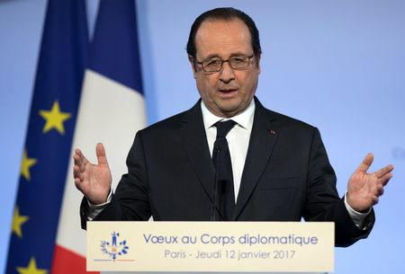 French President Francois Hollande delivers his New Year wishes to members of the foreign diplomatic corps, at the Elysee Palace in Paris