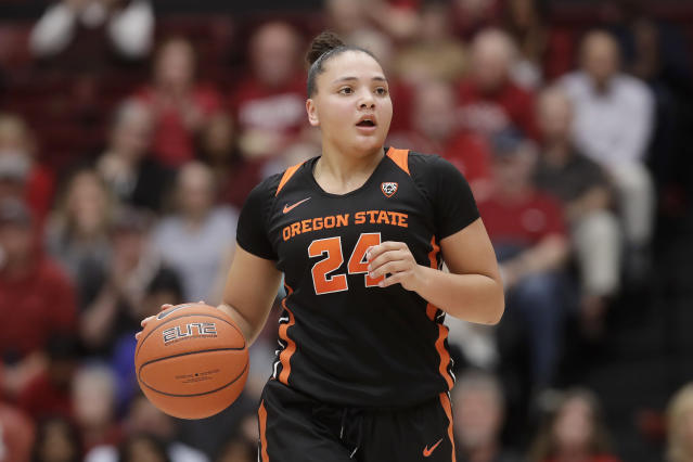 Oregon State guard Destiny Slocum (24) dribbles the ball up the court against Stanford during the second half of an NCAA college basketball game in Stanford, Calif., Friday, Feb. 21, 2020. (AP Photo/Jeff Chiu)