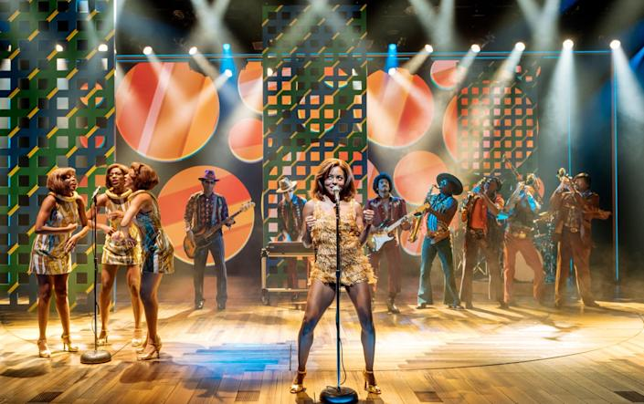 """Adrienne Warren, center, and the company of """"Tina: The Tina Turner Musical."""""""