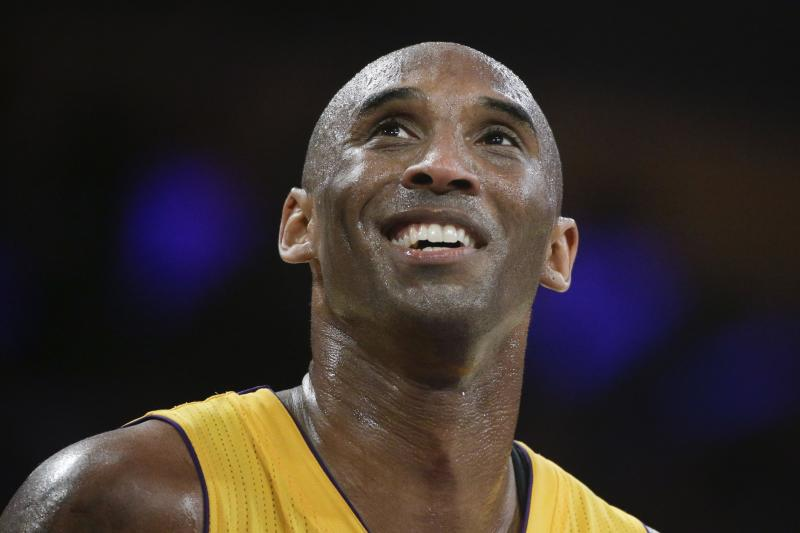 FILE - In this April 13, 2016, file photo, Los Angeles Lakers forward Kobe Bryant smiles during the first half of his last NBA basketball game, against the Utah Jazz in Los Angeles. The Naismith Memorial Basketball Hall of Fame was gearing up for a great year: not just the certain election of NBA superstars like Kobe Bryant, Kevin Garnett and Tim Duncan, but also a chance to unveil a completely renovated museum. Because of the coronavirus outbreak, the reopening has been pushed back two months to July 1 and the induction ceremony is being postponed, either to October or the spring. (AP Photo/Jae C. Hong, File)