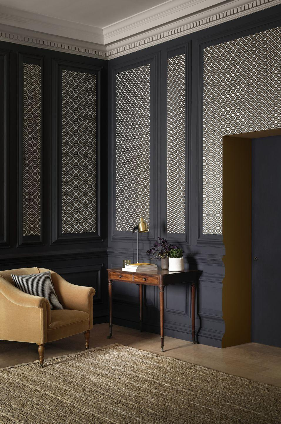 """<p>Create interest with wallpaper panels. This all over lattice design works perfectly against the dark grey; it's a subtle pattern and not too big but it stands out. The design is reminiscent of tiles and has a touch of Morocco about it.</p><p>Top Tip: This living room wallpaper idea works particularly well tall ceilings.</p><p>Pictured: Quatrefoil Kohl wallpaper, <a href=""""https://www.paintandpaperlibrary.com/quatrefoil-kohl"""" rel=""""nofollow noopener"""" target=""""_blank"""" data-ylk=""""slk:Paper Library"""" class=""""link rapid-noclick-resp"""">Paper Library</a></p>"""