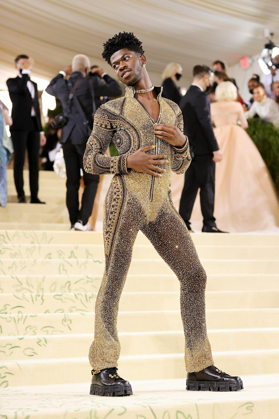 Lil Nas X's star scintillates brighter and brighter with each passing day, whether it's pulling off several different sexy, shocking looks at the Met Gala (like the one pictured).