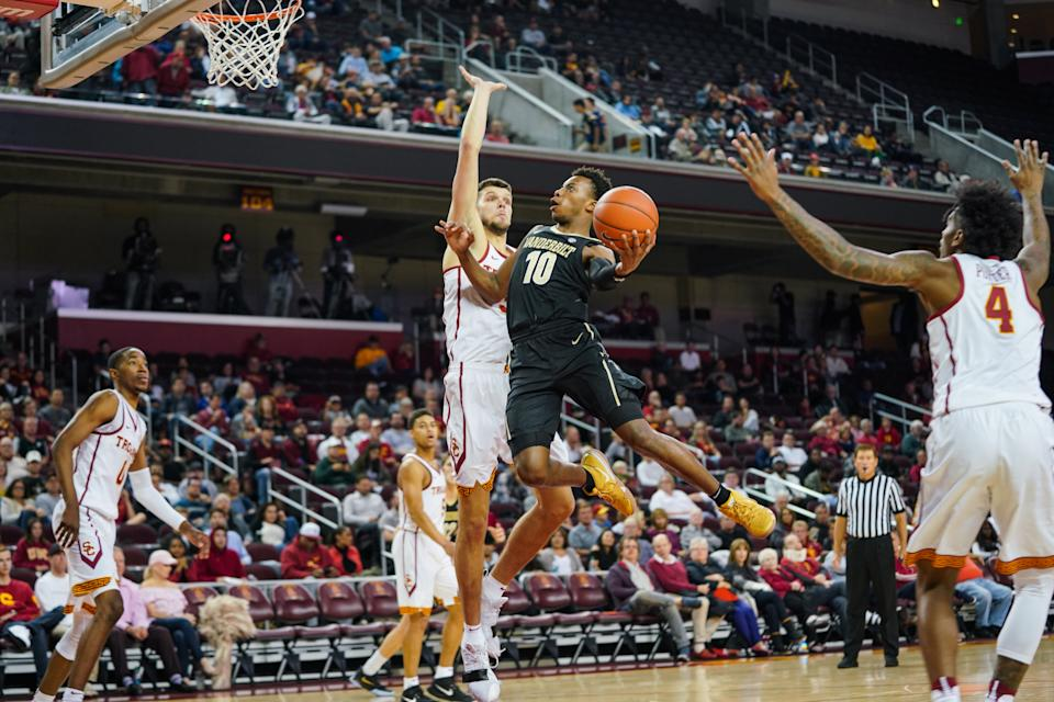 LOS ANGELES, CA - NOVEMBER 11:  Darius Garland #10 of the Vanderbilt Commodores shoots a shot over Nick Rakocevic #31 of the USC Trojans during a game at The Galen Center on November 11, 2018 in Los Angeles, California.  (Photo by Cassy Athena/Getty Images)