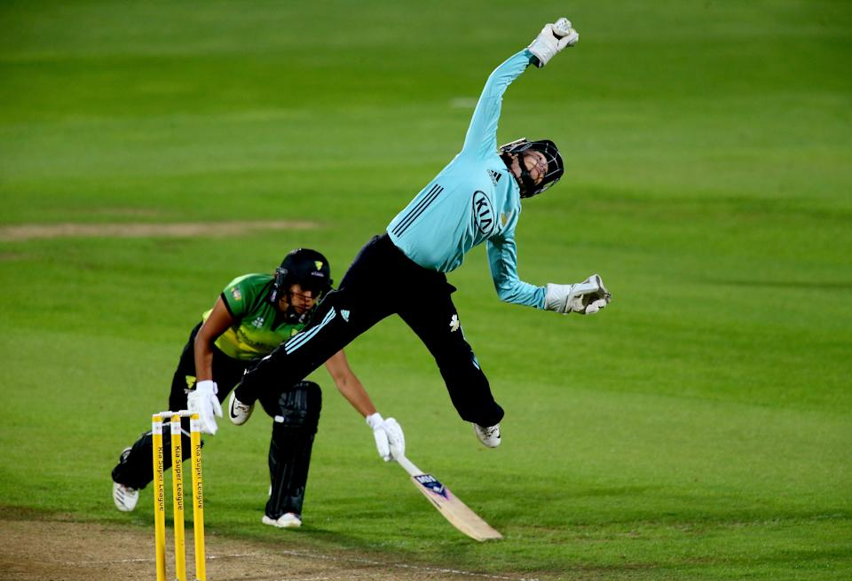 LONDON, ENGLAND - AUGUST 18:  Sarah Taylor of Surrey Stars jumps to reach a ball as Naomi Dattani of Western Storm dives to make her ground during the Women's Kia Super League match between Surrey Stars and Western Storm at The Kia Oval on August 18, 2018 in London, England.  (Photo by Jordan Mansfield/Getty Images)