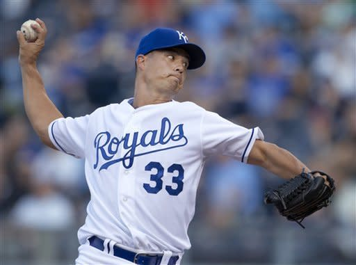 Kansas City Royals starter Jeremy Guthrie pitches to an Oakland Athletics batter during the first inning of a baseball game at Kauffman Stadium in Kansas City, Mo., Tuesday, Aug. 14, 2012. (AP Photo/Orlin Wagner)