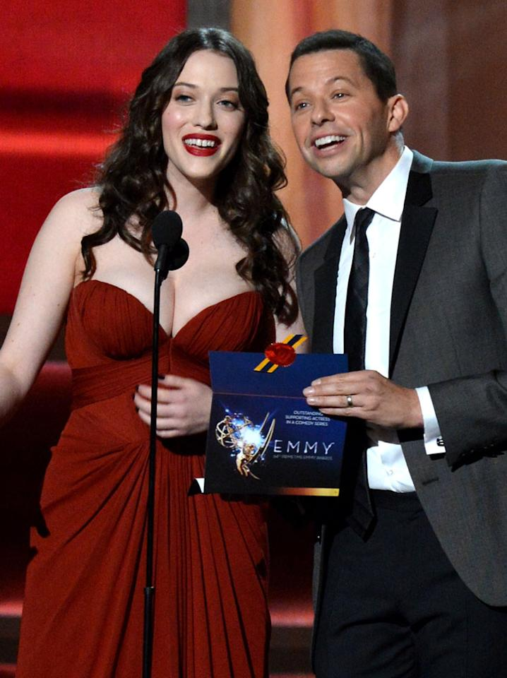Kat Dennings and Jon Cryer onstage at the 64th Primetime Emmy Awards at the Nokia Theatre in Los Angeles on September 23, 2012.