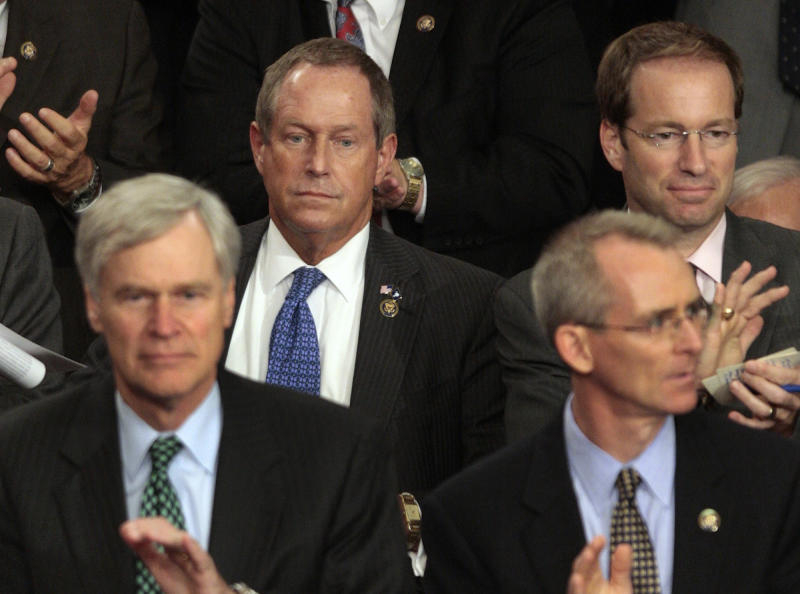 "FILE - In this Wednesday, Sept., 9, 2009 file photo, Rep. Joe Wilson, R-S.C., center, listens during President Barack Obama's speech on health care to a joint session of Congress on Capitol Hill in Washington. During the address, Wilson shouted, ""You lie!"" The statement was seen by many observers and commentators as a breathtaking show of disrespect aimed at a black president. (AP Photo/Pablo Martinez Monsivais)"