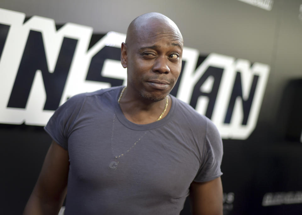 """Dave Chappelle arrives at the premiere of """"BlacKkKlansman"""" on Wednesday, Aug. 8, 2018, at the Samuel Goldwyn Theater in Beverly Hills, Calif. (Photo by Richard Shotwell/Invision/AP)"""