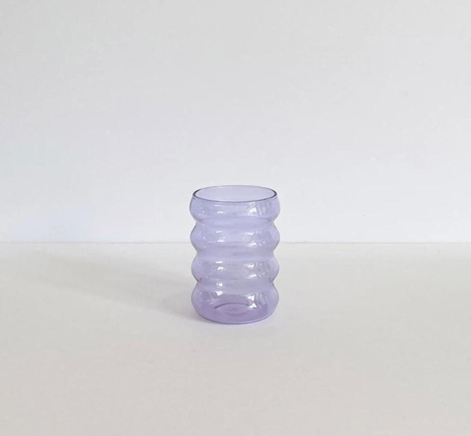 <p><span>The Ripple Glass</span> ($25), designed by Sophie Lou Jacobsen, is a functional, multipurpose household item that would look great on a bathroom sink. Made from light, airy glass, it comes in lilac, clear, and amber.</p>