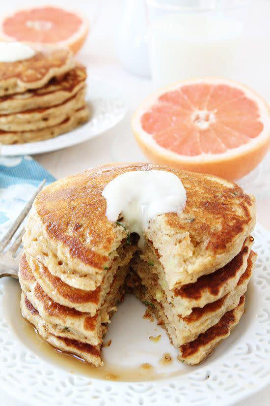 "<strong>Get the <a href=""http://www.twopeasandtheirpod.com/whole-wheat-zucchini-pancakes/"" rel=""nofollow noopener"" target=""_blank"" data-ylk=""slk:Whole Wheat Zucchini Pancakes recipe"" class=""link rapid-noclick-resp"">Whole Wheat Zucchini Pancakes recipe</a> from Two Peas and their Pod</strong>"