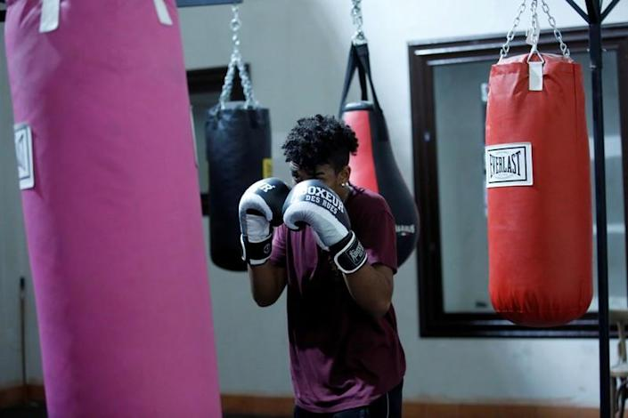 Nico Rodrigues, 21, trains during a boxing class at the Santa Maria della Sanita Basilica in the Rione Sanita neighbourhood in Naples