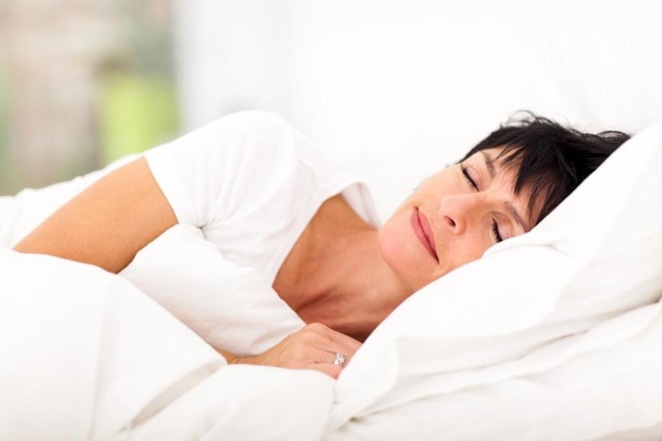 mature woman sleeping on bed