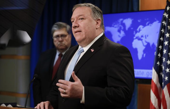 US Secretary of State Mike Pompeo (R) holds a joint news conference on the International Criminal Court with US Attorney General William Barr (L, rear), at the State Department in Washington, DC, on June 11, 2020. (Yuri Gripas/AFP via Getty Images)