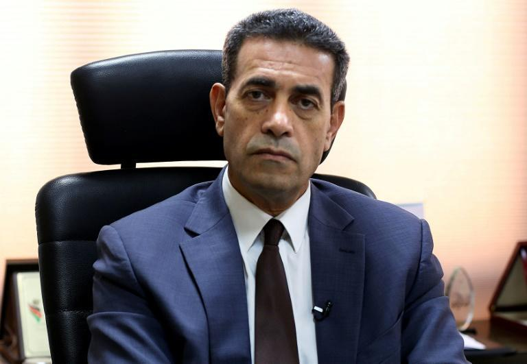 Imed al-Sayeh, head of Libya's High National Election Commission, pauses during an interview with AFP in Tripoli on October 5, 2021 -- he forecasts strong turnout in the ballots (AFP/Mahmud TURKIA)