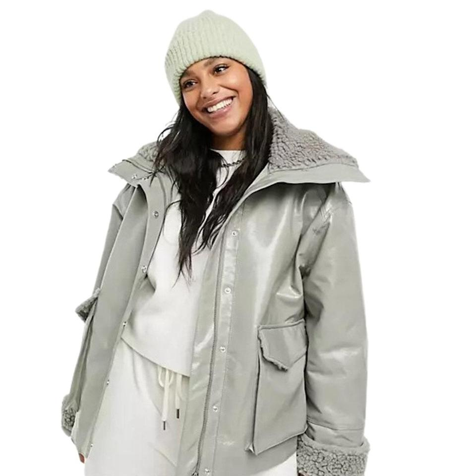 """Just in case you're over the 50 shades of brown, Asos has this gray iteration that's just as effortless to style. Extra points for the fluffy sleeves, which can be uncuffed to warm up your hands. $71, Asos. <a href=""""https://www.asos.com/us/asos-design/asos-design-curve-leather-look-jacket-with-shearling-lining-in-sage/prd/21464751"""" rel=""""nofollow noopener"""" target=""""_blank"""" data-ylk=""""slk:Get it now!"""" class=""""link rapid-noclick-resp"""">Get it now!</a>"""