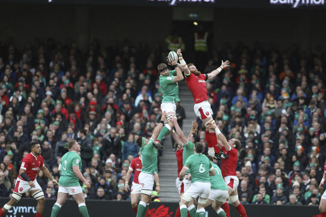 Ireland's Ian Henderson, top left, wins the line out against Wales' Jake Ball during the Six Nations rugby union international between Ireland and Wales at the Aviva Stadium, Dublin, Ireland, Saturday, Feb. 8, 2020. (AP Photo/Peter Morrison)