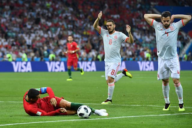 Cristiano Ronaldo was taken down by Nacho for a penalty in the 2018 World Cup Group B match between Portugal and Spain. (Getty)