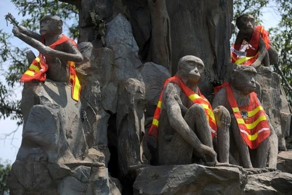 Chinese police install stone monkeys in fluorescent jackets on roadside to curb speeding