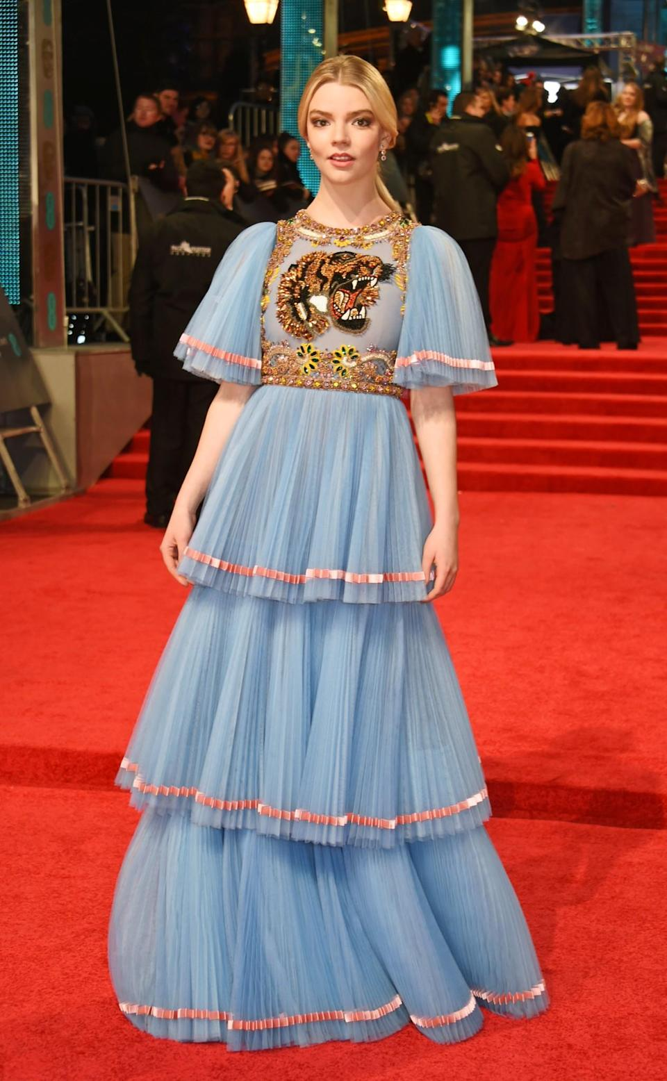 <p>Anya went for a full Gucci look in the form of a light blue ruffled gown. <i>[Photo: Getty]</i> </p>