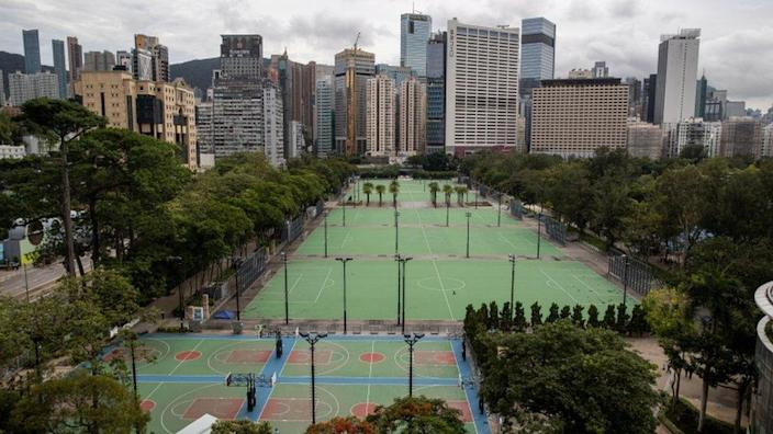 Victoria Park in Hong Kong empties on Friday, June 4, after police close