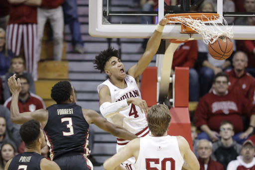 Indiana's Trayce Jackson-Davis (4) dunks against Florida State's Trent Forrest (3) during the second half of an NCAA college basketball game Tuesday, Dec. 3, 2019, in Bloomington, Ind. Indiana won 80-64. (AP Photo/Darron Cummings)