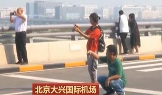 Security staff at Beijing Daxing International Airport are warning camera-happy visitors they could pose a danger to themselves, road users and travellers. Photo: CCTV