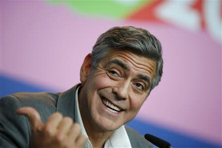 Cast member and director George Clooney reacts during news conference at 64th Berlinale International Film Festival in Berlin