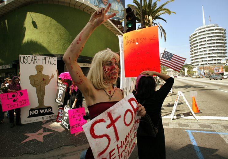 An anti-war demonstration held near the Kodak Theatre on Oscar night in 2003. (Photo: Damian Dovarganes/AP)<br>