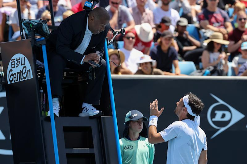 Italy's Fabio Fognini speaks to the umpire after a point against Reilly Opelka of the US during their men's singles match on day two of the Australian Open tennis tournament in Melbourne on January 21, 2020. (Photo by DAVID GRAY / AFP)