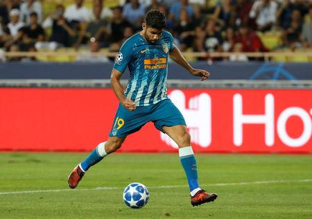 Soccer Football - Champions League - Group Stage - Group A - AS Monaco v Atletico Madrid - Stade Louis II, Monaco - September 18, 2018  Atletico Madrid's Diego Costa scores their first goal   REUTERS/Eric Gaillard