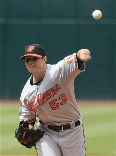 Baltimore Orioles starting pitcher Zach Britton delivers in the first inning of a baseball game against the Cleveland Indians, Sunday, July 22, 2012, in Cleveland. (AP Photo/Tony Dejak)