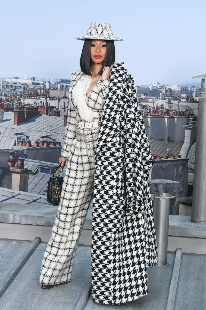 <p>During fashion week Cardi B wore a houndstooth coat to Chanel's show. </p>