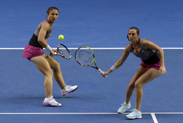 Italy's Sara Errani, left, and Roberta Vinci, right, play Russia's Ekaterina Makarova and Elena Vesnina in their women's doubles final at the Australian Open tennis championship in Melbourne, Australia, Friday, Jan. 24, 2014.(AP Photo/Aijaz Rahi)