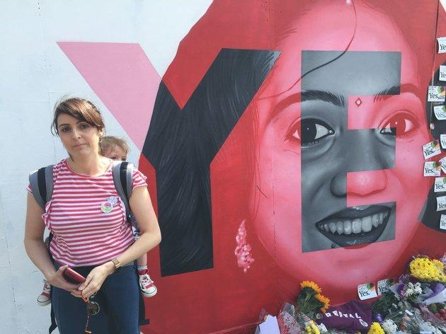 Jill Jordan and baby Ivy pay their tributes at the mural