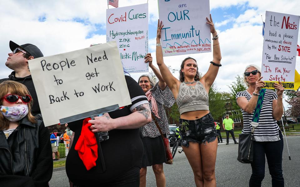 Hundreds gather in Massachusetts on May 16 to push for a reopening of the economy and an end to the current restrictions. Source: Getty