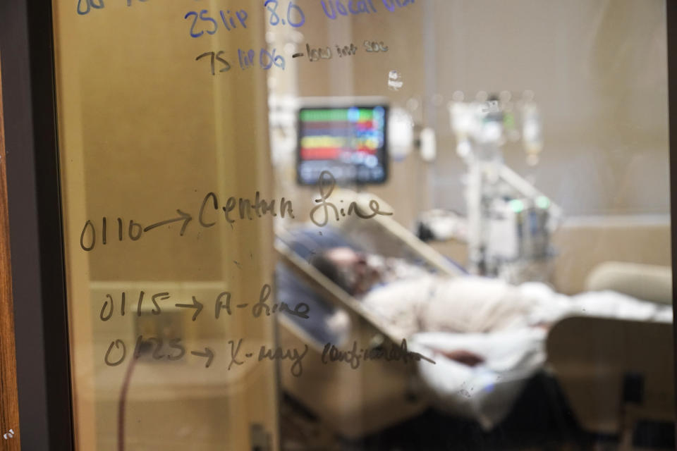 Medical notations are written on a window of a COVID-19 patient's room in an intensive care unit at the Willis-Knighton Medical Center in Shreveport, La., Wednesday, Aug. 18, 2021. The windows were added to the doors to keep the rooms closed for quarantining, which would normally be open in an ICU unit there. (AP Photo/Gerald Herbert)
