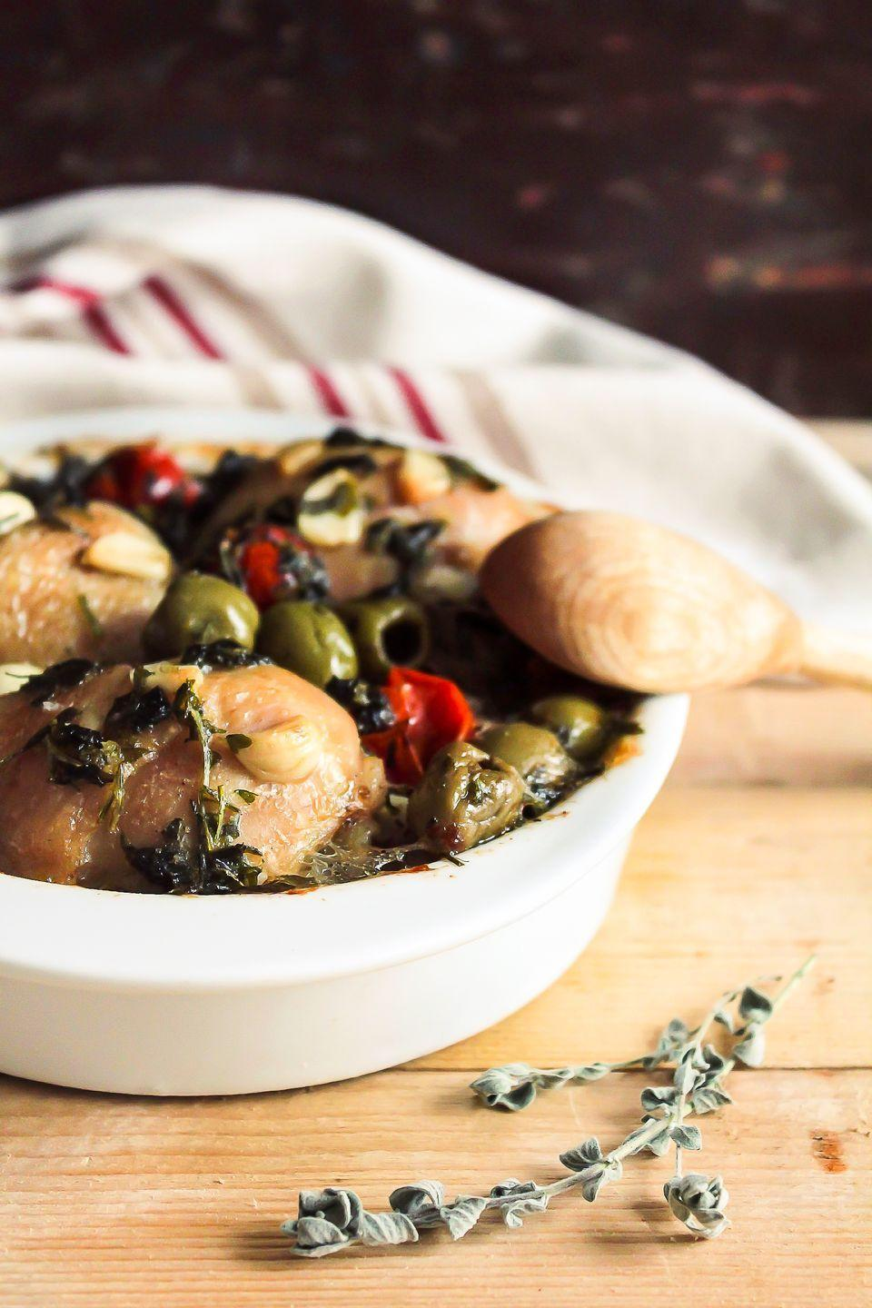 """<p>The fragrance of Rosemary-Garlic Chicken spiked with zesty green olives will entice hungry guests into your kitchen. This dish yields a savory broth; serve it along with a loaf of crusty bread for dipping.</p><p><strong><a href=""""https://www.countryliving.com/food-drinks/recipes/a1619/rosemary-garlic-chicken-3733/https://www.countryliving.com/food-drinks/recipes/a1619/rosemary-garlic-chicken-3733/"""" rel=""""nofollow noopener"""" target=""""_blank"""" data-ylk=""""slk:Get the recipe"""" class=""""link rapid-noclick-resp"""">Get the recipe</a>.</strong></p>"""