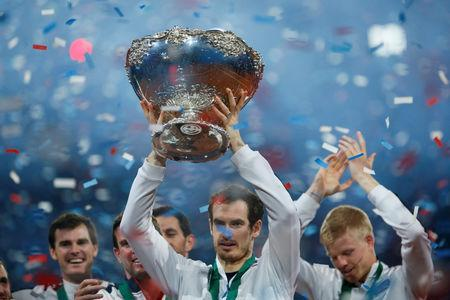 FILE PHOTO: Britain's Andy Murray celebrates with the trophy after winning the Davis Cup at Flanders Expo, Ghent, Belgium - 29/11/15. Action Images via Reuters / Jason Cairnduff