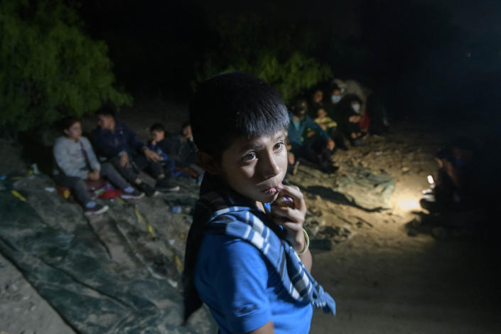 In a photo taken on March 27, 2021 unaccompanied Guatemalan child, Oscar (12), who arrived illegally across the Rio Grande river from Mexico, stands after disembarking from a boat near the US border city of Roma, Texas. (Ed Jones/AFP via Getty Images)