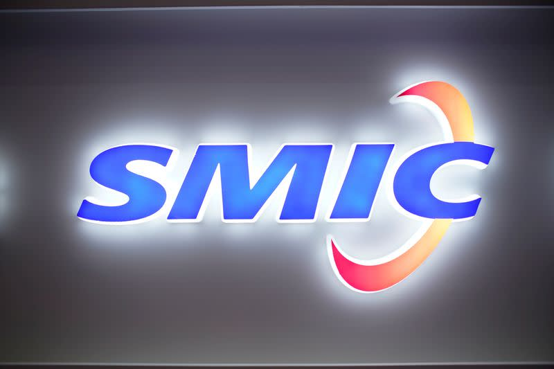 FILE PHOTO: A logo of Semiconductor Manufacturing International Corporation (SMIC) is seen at China International Semiconductor Expo (IC China 2020) in Shanghai, China October 14, 2020.
