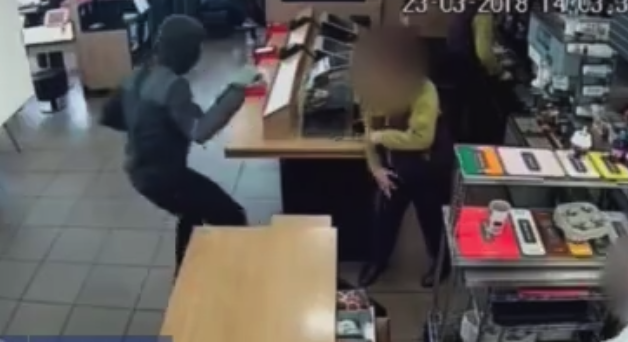 The man is then seen threatening staff before making his escape (SWNS)