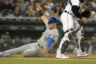 Kansas City Royals' Ryan O'Hearn slides safely home on a sacrifice fly from Whit Merrifield in the third inning of a baseball game against the Detroit Tigers, Friday, Sept. 24, 2021, in Detroit. (AP Photo/Jose Juarez)