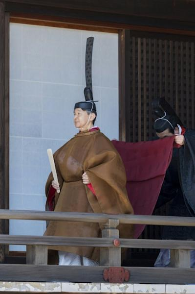 The emperor will wear a voluminous robe and a hat topped with a towering black tail