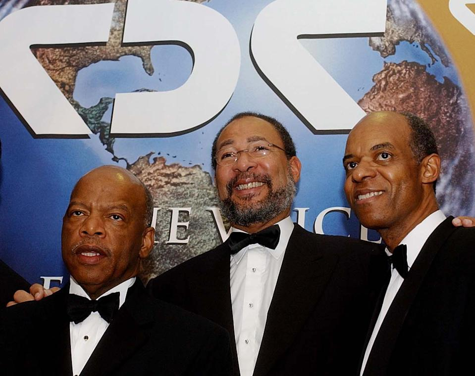 From left, Rep. John Lewis, D-Ga., Richard Parsons ceo of AOL Time-Warner, and Rep. William Jefferson, D-La., pose for photographers at the Congressional Black Caucus Foundation dinner, Saturday, Sept. 14, 2002, in Washington. (AP Photo/Ken Lambert)