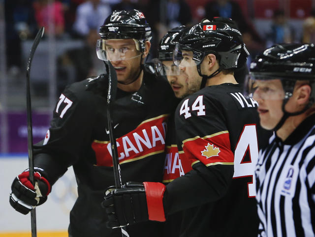 Team Canada celebrates a first period goal against Austria during a men's ice hockey game at the 2014 Winter Olympics, Friday, Feb. 14, 2014, in Sochi, Russia. (AP Photo/Mark Humphrey)