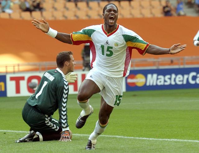 FILE - In this June 6, 2002 file photo Senegal's Salif Diao reacts after he beat Denmark's goalkeeper Thomas Sorensen, left, to score the equalizer during their 2002 World Cup Group A soccer match at the Daegu World Cup stadium in Daegu, South Korea. (AP Photo/Amy Sancetta, file)