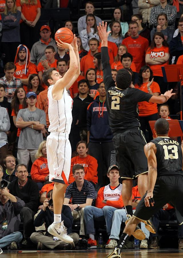 Virginia's Mike Tobey (10) shoots over Wake Forest' Devin Thomas (2) during the first half of an NCAA college basketball game Wednesday, Jan. 8, 2014, in Charlottesville, Va. (AP Photo/Andrew Shurtleff)