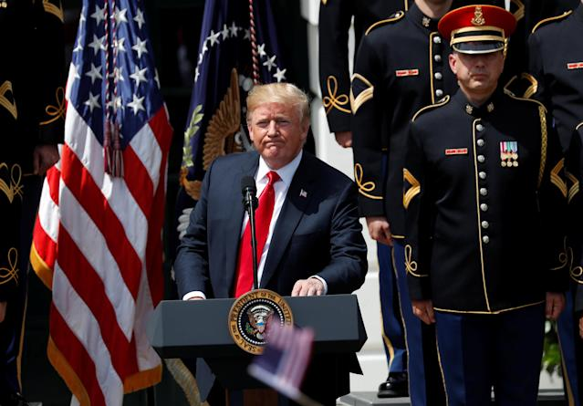 "U.S. President Donald Trump concludes his ""celebration of America"" event with the United States Army Chorus on the South Lawn of the White House in Washington, U.S., June 5, 2018. The event was arranged after Trump canceled the planned visit of the Super Bowl champion Philadelphia Eagles to the White House. REUTERS/Kevin Lamarque"