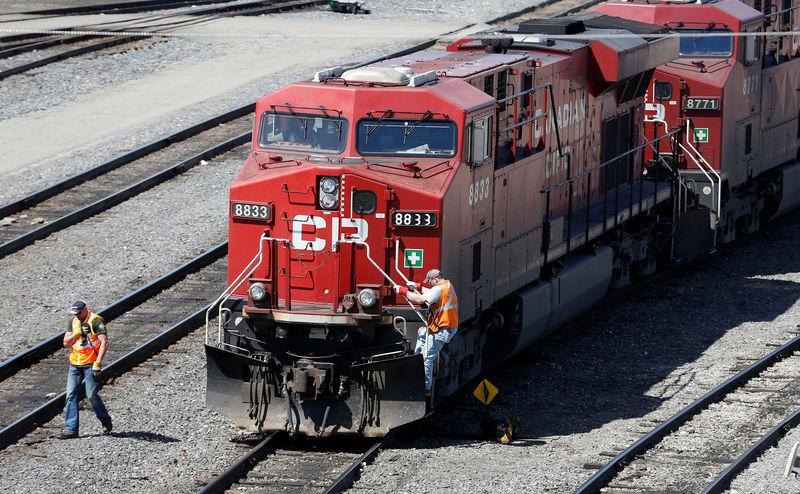 FILE PHOTO: A Canadian Pacific Railway crew works on their train at the CP Rail yards in Calgary