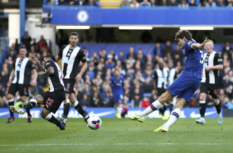 Chelsea's Marcos Alonso scores his side's first goal during the British Premier League soccer match between Newcastle United and Chelsea, at Stamford Bridge, London, Saturday, Oct. 19, 2019. (Steven Paston/PA via AP)